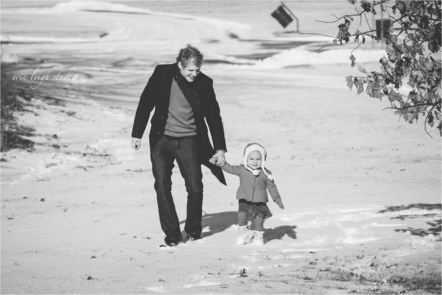 walking with daddy in the snow at ironwoods park in leawood, ks