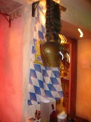 A German cow bell over the Bavarian Flag