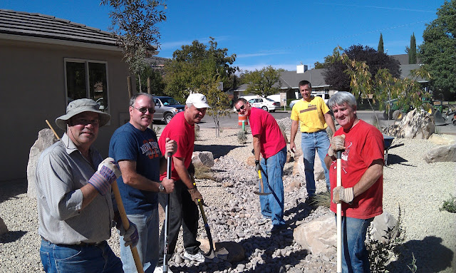 Real Estate Agents from the area assist with new home project for disabled St. George resident.