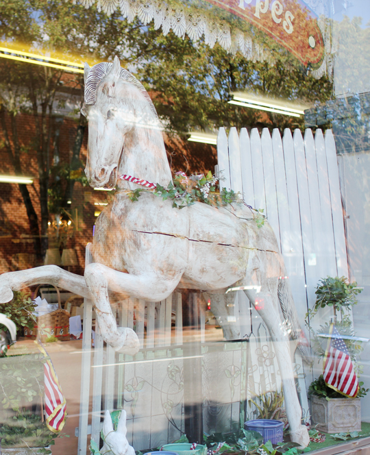 horse in an antique shop window