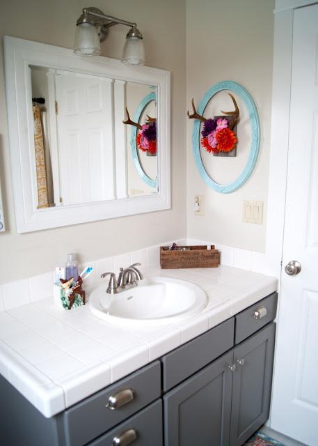 Project Kid's Bathroom Makeover - before & after - Martha Stewart Zinc on vanity antler hair clip organizer