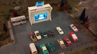 a model drive-in movie theater as part of a model railroad display