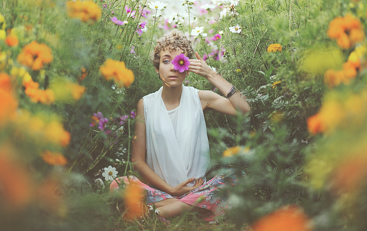 photography of das sheep seating in the middle of flowers, in a romantic pink outfit