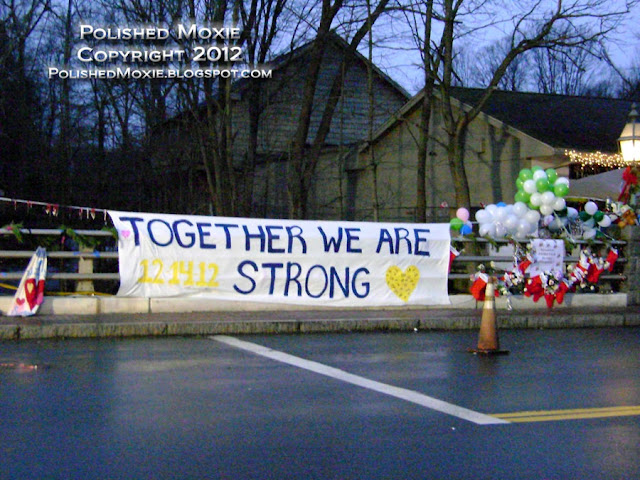Image of sign and Christmas stocking hanging on bridge in Sandy Hook.
