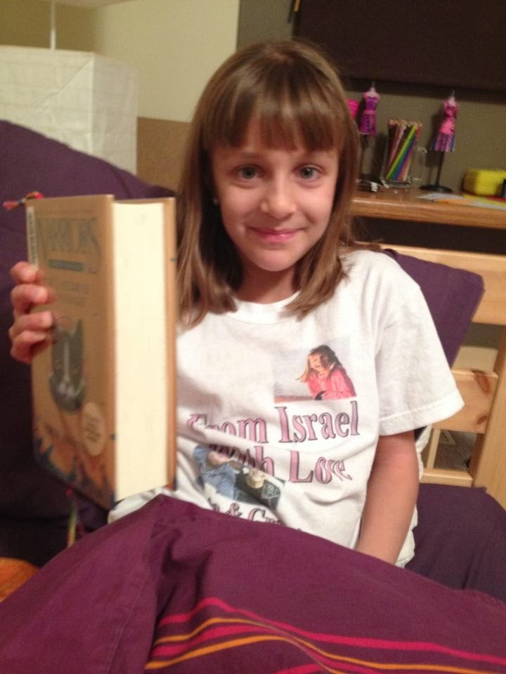 Abby with new shirt and new book