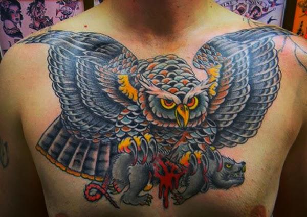 Tattoo of an owl clutching a bleeding rat in its talons by Tattoo artist Mark Stewart for Triumph Tattoo