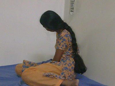 School girl with oiled long hair braid