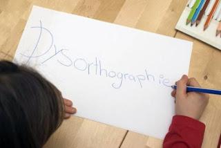 enfant écriture cursive dysorthographie