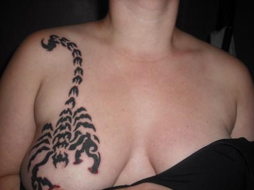 Breast Scorpio Tattoo