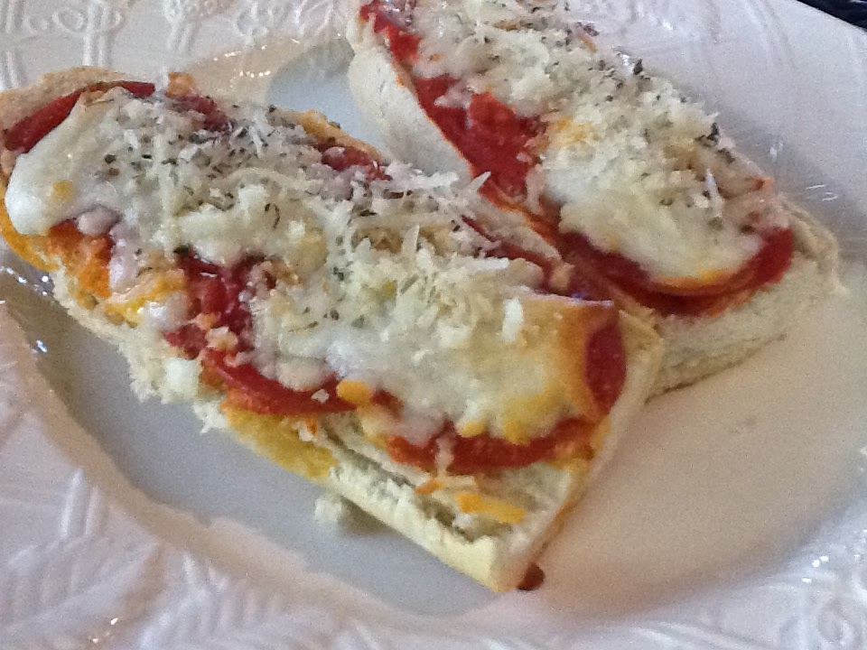 Here's an easy meal for Summer...French bread pizza. Who doesn't love...