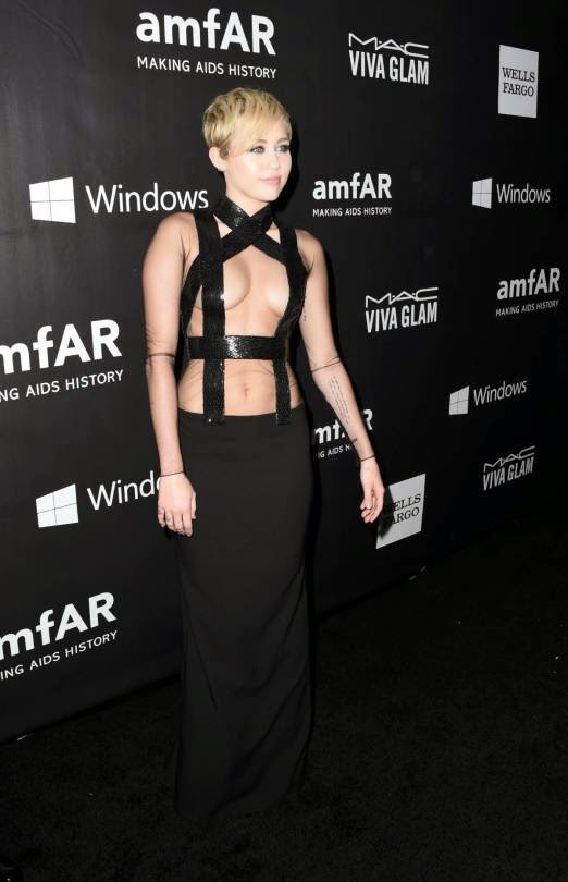 Miley Cyrus wears a dominatrix inspired gown to the 2014 amfAR LA Inspiration Gala