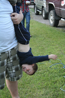 Child giggles while turned upside down photo