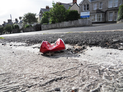 Coca-Cola tin on road