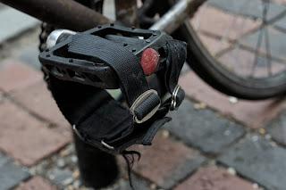 Single speed bicycle bike boylston st boston usa the biketorialist oury grips bmx style handlebar rust track frame flat platform pedal