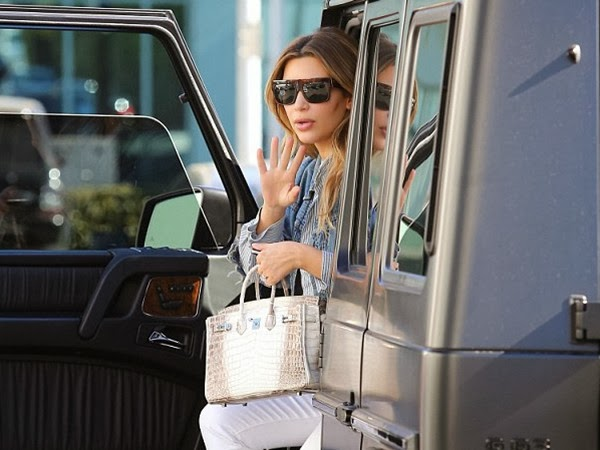 Kim Kardashian Makes A Stylish Exit from Mercedes-Benz SUV in Black Shades