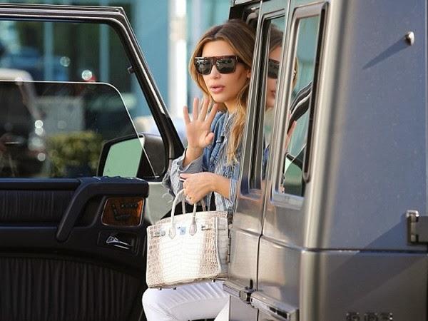Kim Kardashian Makes A Stylish Exit from Mercedes-Benz SUV in Black Shades