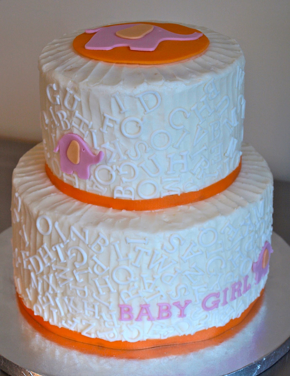 a party style elephant baby shower cake