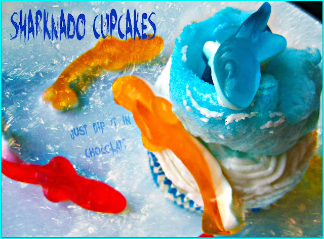 "Shark Week ""Sharknado"" Cupcakes Recipe, take a bite out of Shark Week with these airy and delicious cupcakes! Filled with Very Berry ""Blood"" they are sure to be a hit, just like the movie, when served in a fun Luau, Halloween Party or just a fun gathering !"