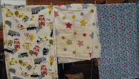 cottons and polycottons printed with stars and transport motifs