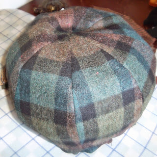 Eight-paneled crown for 'newsboy' style hat in green and brown plaid