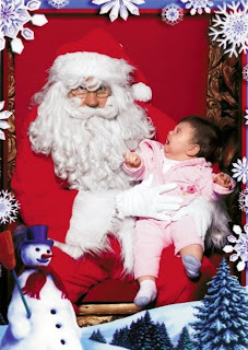 funny picture: child scared of Santa Claus