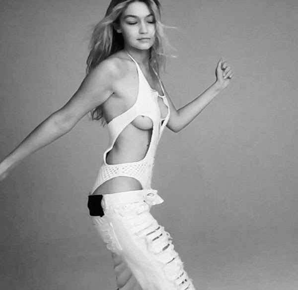 Gigi Hadid showcases side boob and dances for the Love Magazine Advent Calendar Video