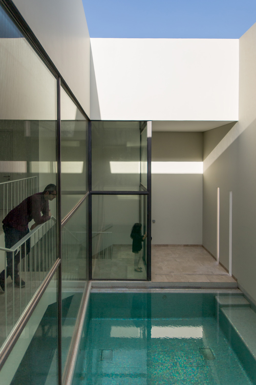 Arquitectura arquidea green core apartamentos con for Casas con patio interior