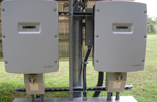 Pair of inverters to change the DC power produced by the solar panels into AC power for the grid