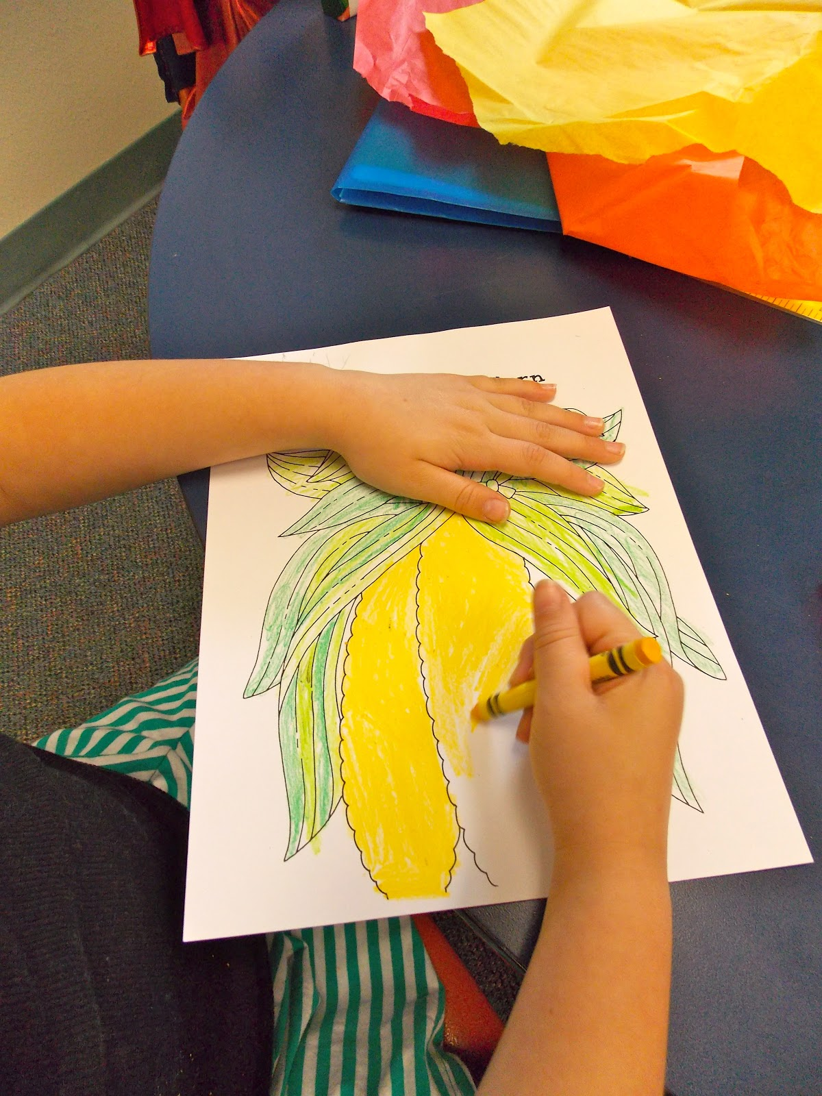 Tear fall colored construction paper into small pieces and glue - Step 2 Tear Off Pieces Of Tissue Paper And Roll Them Into Little Balls Then Glue Them All Over The Indian Corn