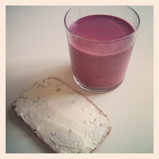 blueberry and raspberry smoothie and whole wheat sour dough bread with philadelphia cheese