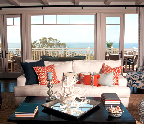 Go coastal with blue and orange room decor completely for Orange and blue living room ideas