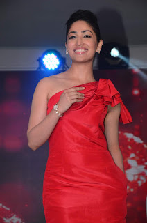Yami Goutham looks lovely spicy in red gown at Titan Raga event