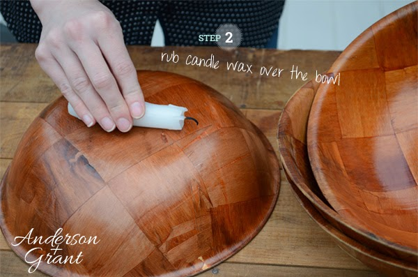 Step 2 for making DIY Distressed Bowls is to rub candle wax over the bowl | www.andersonandgrant.com