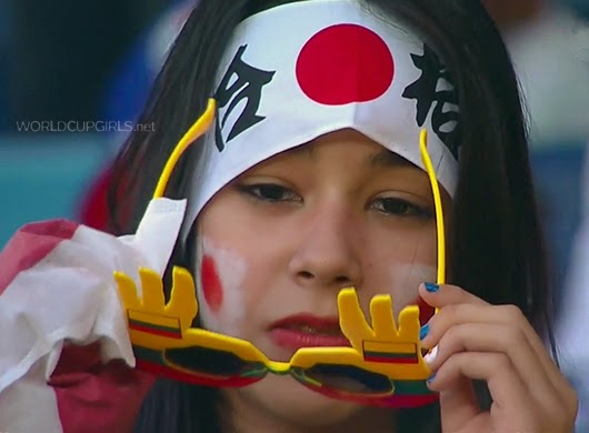 Beautiful Japanese girl watching the World Cup 2014