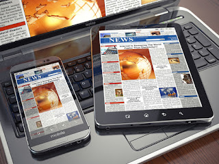 Pic of laptop with iPad and smartphone resting on top
