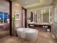 Decoracion de baño moderno con tina de hidromasaje central