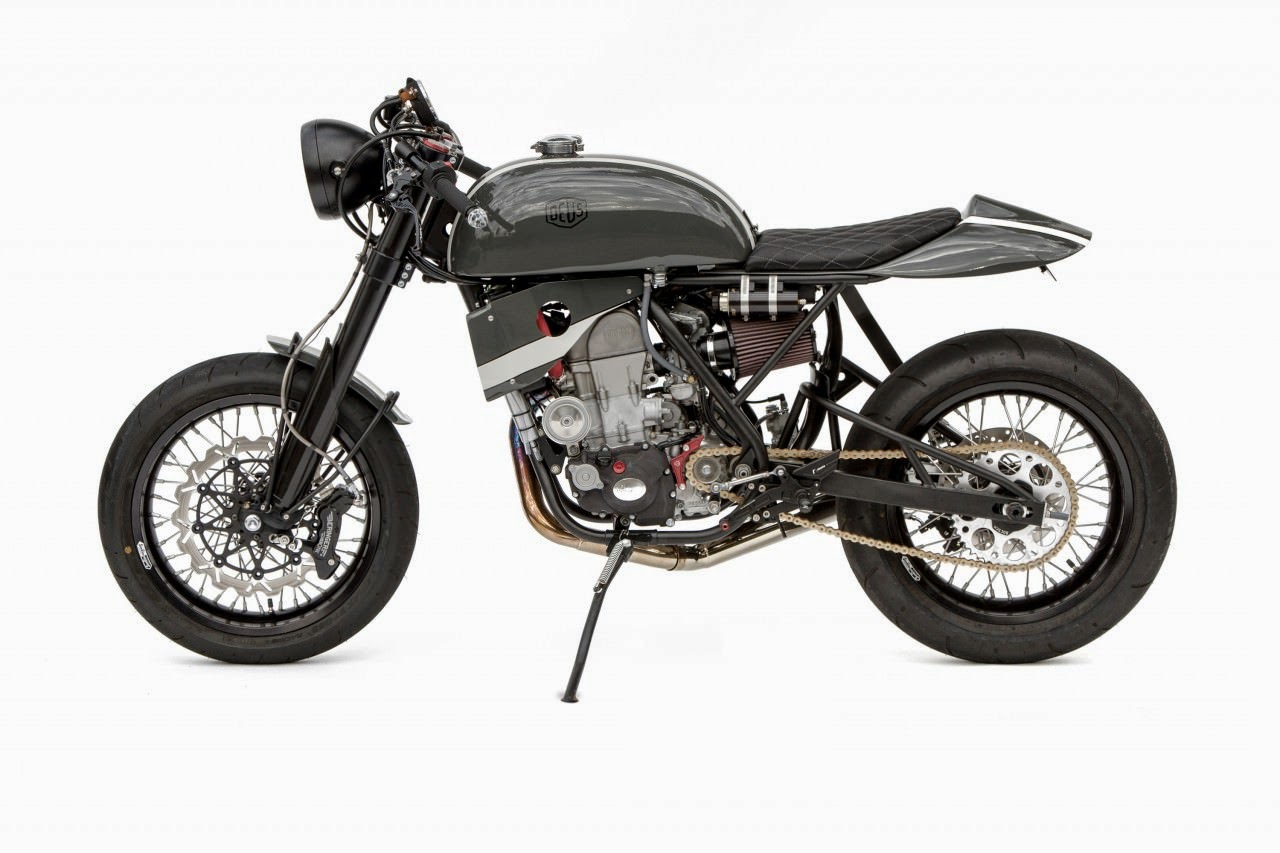 Honda CRF450X Cafe Racer Custom Honda CRF450X Cafe Racer by Deus Ex Machina. Honda CRF450X a dirt bike which was highly customised to be come a Honda CRF450X cafe racer in  Deus California. Honda CRF450X Cafe Racer features are custom cafe racer gas tank, custom muffler, custom cafe racer seat, custom cafe racer clip-on handle bars. custom radiator cowl. Honda CRF450X Cafe Racer is one unique road legal bike from Deus Ex Machina. the custom fenders makes it a beauty. Dakdaak is the name given to this Honda Cafe Racer by woolie.