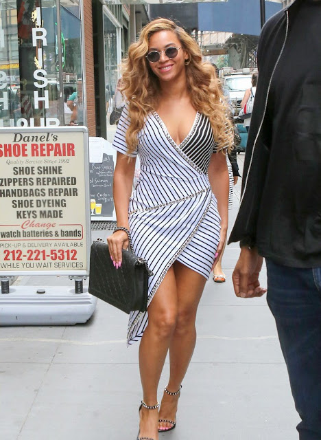 Actress, Singer @ Beyonce displays striped wrap dress in New York