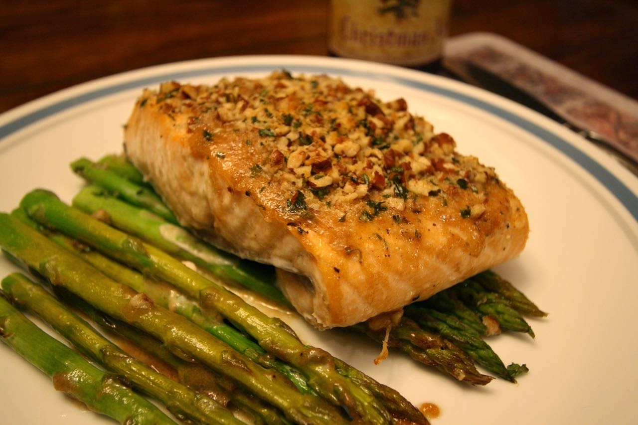 ... baked dijon pecan-crusted salmon on a bed of asparagus. More than