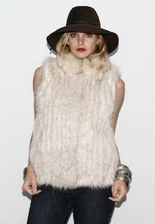 Vintage 1970's bohemian white fox fur gillet vest with hidden front closure.