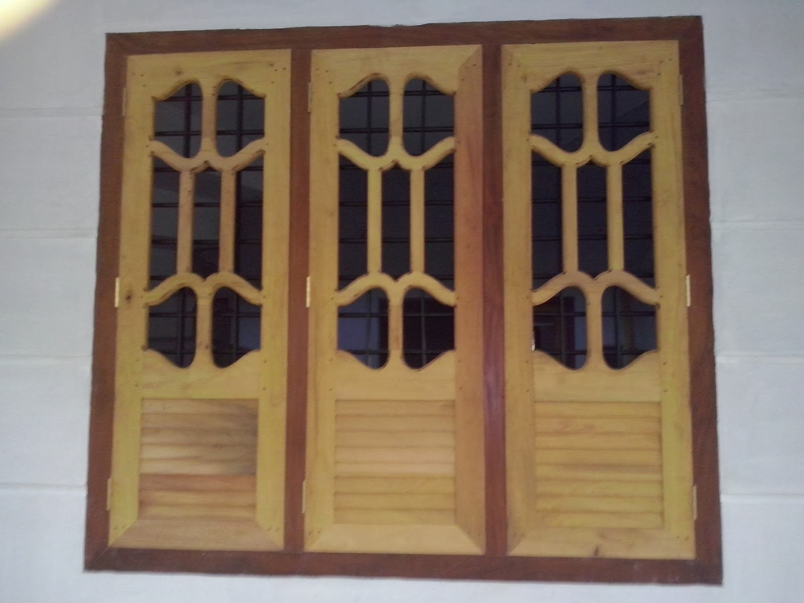 Bavas wood works window door design pictures for Wooden window design with glass