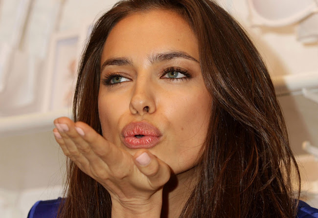Last kiss from IRINA SHAYK at Intimissimi's The Perfect Bra promotion in London