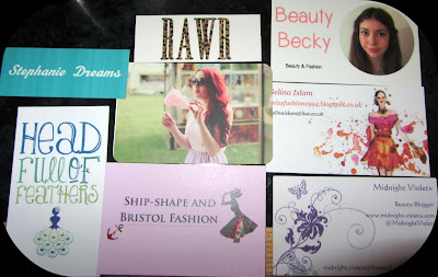 A picture of various beauty and fashion blogger business cards