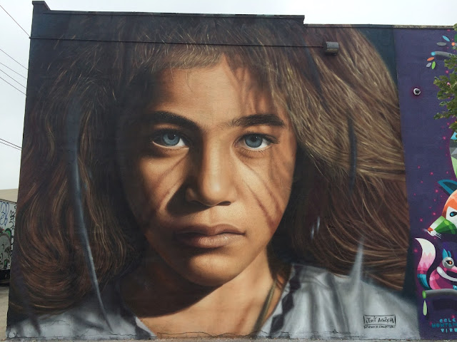 Italian photorealistic painter Jorit Agoch spent several days in The Bushwick Collective at the corner of Jefferson and St. Nicholas creating this amazing portrait of a luxuriously haired child.