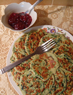 Plate of Spinach Pancakes and bowl of preserves