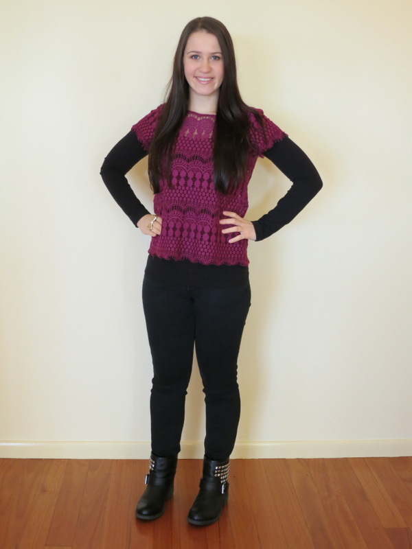Black jeans, long sleeve top and boots with purple lace top and military style jacket