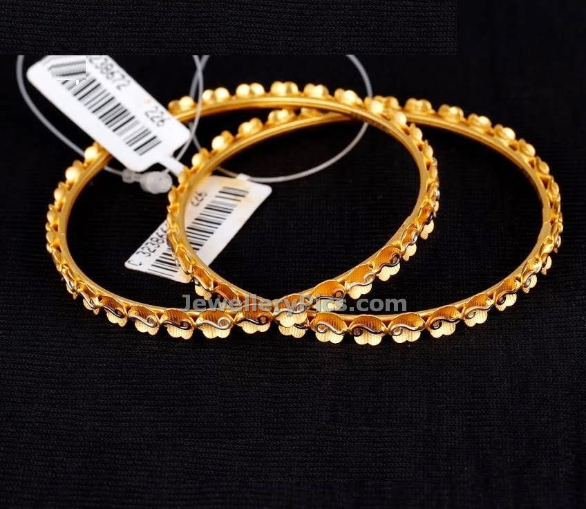 gold desined flower model bangles