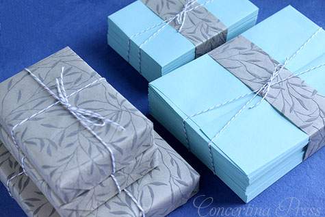aqua wedding invitation envelopes and textured gray paper is a pretty color pairing for a beach wedding