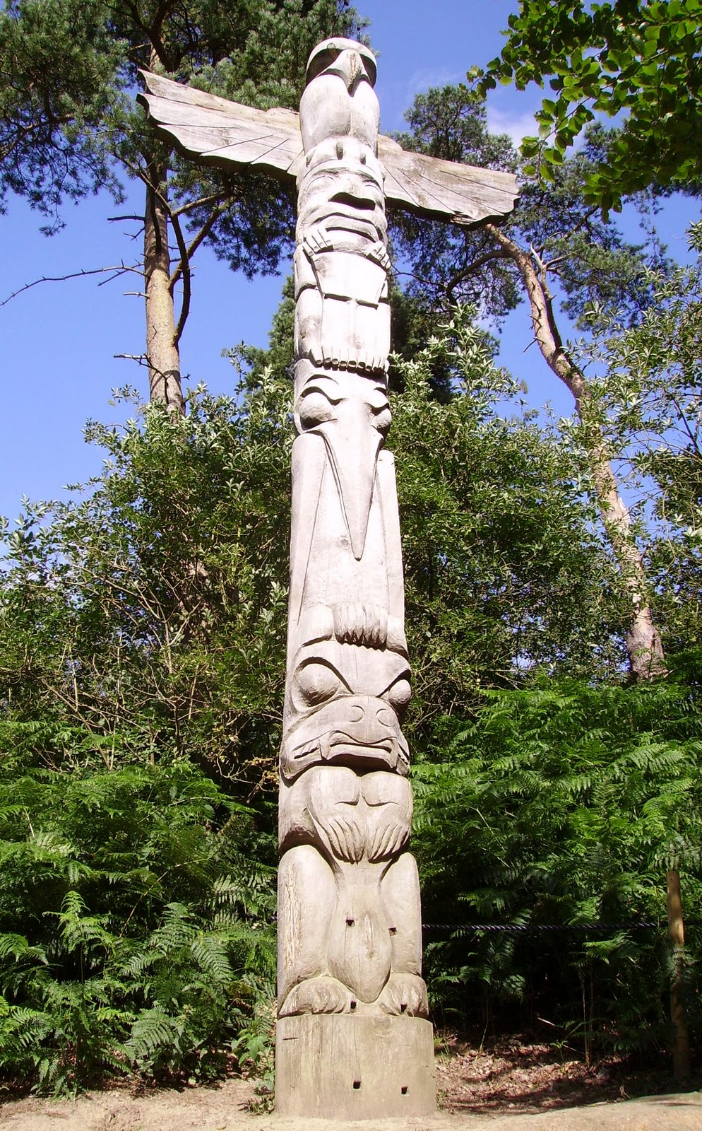 totem poles as a spiritual form Totem poles were built by about 30 native american tribes living along the northwest pacific coast of north america these wooden towers, carved with images of animals and symbols, were monuments expressing a family's status within a tribe.