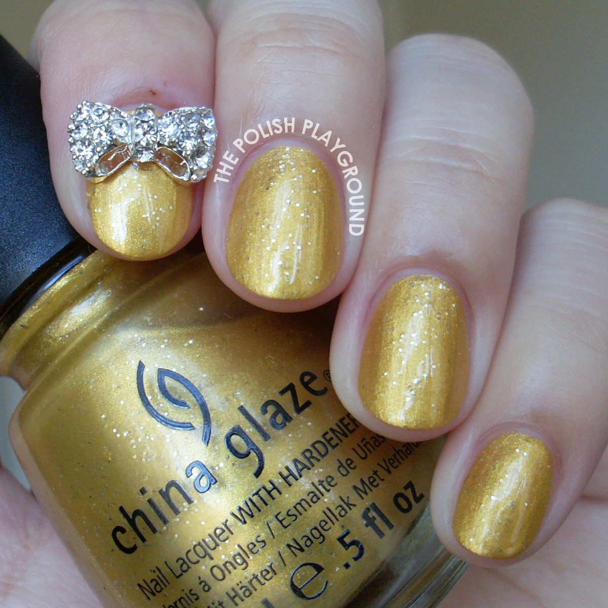 China Glaze Champagne Bubbles with Bow Stud Accent Nail Art